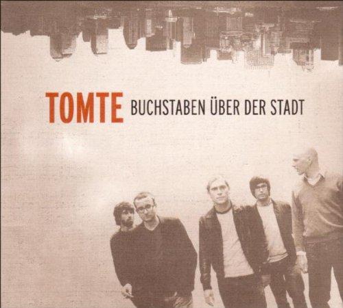 Tomte - Buchstaben über der stadt